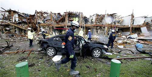 "<div class=""meta ""><span class=""caption-text "">Firefighter conduct search and rescue of an apartment destroyed by an explosion at a fertilizer plant in West, Texas, Thursday, April 18, 2013.  A massive explosion at the West Fertilizer Co. killed as many as 15 people and injured more than 160, officials said overnight.    (Photo/LM Otero)</span></div>"