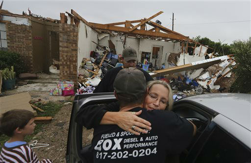 "<div class=""meta ""><span class=""caption-text "">Lisa Montgomery, right, hugs her nephew Jeremy Hulce as her sons Dillon Montgomery, 10, left, and Derrek Girsham look on in front of her home that was destroyed by a tornado in Cleburne, Texas, Thursday, May 16, 2013.  Ms. Montgomery rode out the twister the night before in her bathtub with her 10-year-old son.   (AP Photo/ LM Otero)</span></div>"