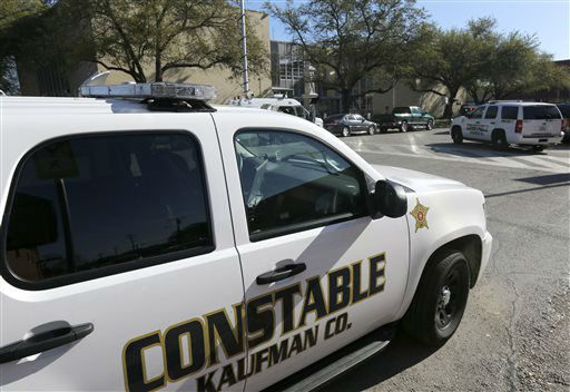"<div class=""meta ""><span class=""caption-text "">Kaufman county law enforcement vehicles are shown parked across the street from the county courthouse, rear, Monday, April 1, 2013, in Kaufman, Texas.   Law enforcement officials throughout Texas remained on high alert Monday seeking to better protect prosecutors and their staffs following the killing of county district attorney whose assistant was gunned down just months ago.   (AP Photo/ Tony Gutierrez)</span></div>"