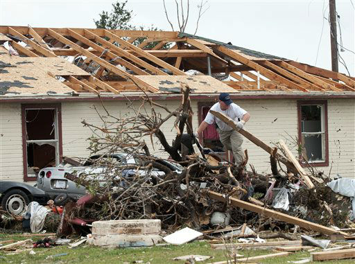 "<div class=""meta image-caption""><div class=""origin-logo origin-image ""><span></span></div><span class=""caption-text"">A police officer looks through debris near Granbury, Texas on Thursday, May 16, 2013.  Ten tornadoes touched down in several small communities in Texas overnight, leaving at least six people dead, dozens injured and hundreds homeless. Emergency responders were still searching for missing people Thursday afternoon.   (AP Photo/ Rex C. Curry)</span></div>"