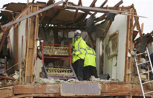 A firefighter handles a children&#39;s bunk bed during a search and rescue of an apartment destroyed by an explosion at a fertilizer plant in West, Texas, Thursday, April 18, 2013.  A massive explosion at the West Fertilizer Co. killed as many as 15 people and injured more than 160, officials said overnight.   <span class=meta>(Photo&#47;LM Otero)</span>