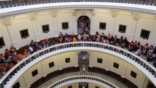"<div class=""meta image-caption""><div class=""origin-logo origin-image ""><span></span></div><span class=""caption-text"">A line to enter the Senate Chamber spills into the rotunda as Sen. Wendy Davis, D-Fort Worth, filibusters in an effort to kill an abortion bill, Tuesday, June 25, 2013, in Austin, Texas. The bill would ban abortion after 20 weeks of pregnancy and force many clinics that perform the procedure to upgrade their facilities and be classified as ambulatory surgical centers.   (AP Photo/ Eric Gay)</span></div>"