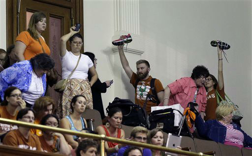 "<div class=""meta image-caption""><div class=""origin-logo origin-image ""><span></span></div><span class=""caption-text"">Member of the gallery respond by holding up their shoes as Sen. Wendy Davis, D-Fort Worth, is called for a third and final violation in rules to end her filibuster attempt to kill an abortion bill, Tuesday, June 25, 2013, in Austin, Texas. The bill would ban abortion after 20 weeks of pregnancy and force many clinics that perform the procedure to upgrade their facilities and be classified as ambulatory surgical centers.    (AP Photo/ Eric Gay)</span></div>"