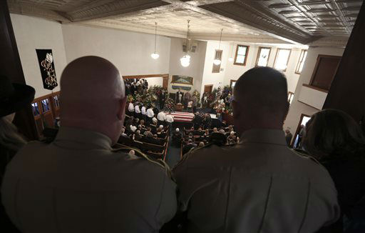 The First Baptist Church of Wortham is packed with family, friends and law enforcement officers during the funeral for Kaufman County District Attorney Mike McLelland and his wife, Cynthia, Friday, April 5, 2013, in Wortham, Texas. The couple was found shot to death Saturday in their house near Forney, about 20 miles east of Dallas. No arrests have been made.   <span class=meta>(AP Photo&#47; LM Otero)</span>