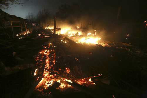 "<div class=""meta ""><span class=""caption-text "">The remains of a home burn early Thursday morning, April 18, 2013, after a fertilizer plant exploded Wednesday night in West, Texas. The massive explosion killed as many as 15 people and injured more than 160, shaking the ground with the strength of a small earthquake and leveling homes and businesses for blocks in every direction.   (Photo/LM Otero)</span></div>"
