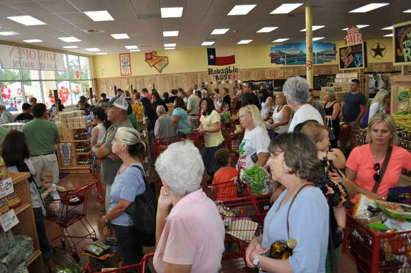"<div class=""meta image-caption""><div class=""origin-logo origin-image ""><span></span></div><span class=""caption-text"">Shoppers flocked to the opening of Trader Joe's new store in The Woodlands on June 15, 2012. (KTRK Photo)</span></div>"
