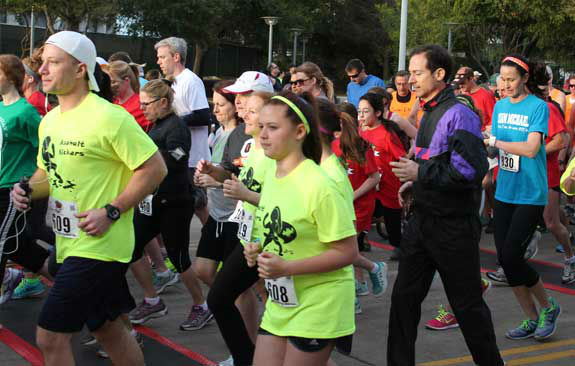 "<div class=""meta ""><span class=""caption-text "">Runners and walkers raised money for brain cancer research and children's programs at Memorial Hermann Hospital Sunday, March 30, 2014, in the annual Run for the Rose.  The event began 12 years ago and honors Dr. Marnie Rose, who was in the first year of her pediatric medical residency at Children's Memorial Hermann Hospital when she was diagnosed with brain cancer.Were you there?  If so, send your photos to us at news@abc13.com and we'll add them here. (Photo/Meryl Walker)</span></div>"