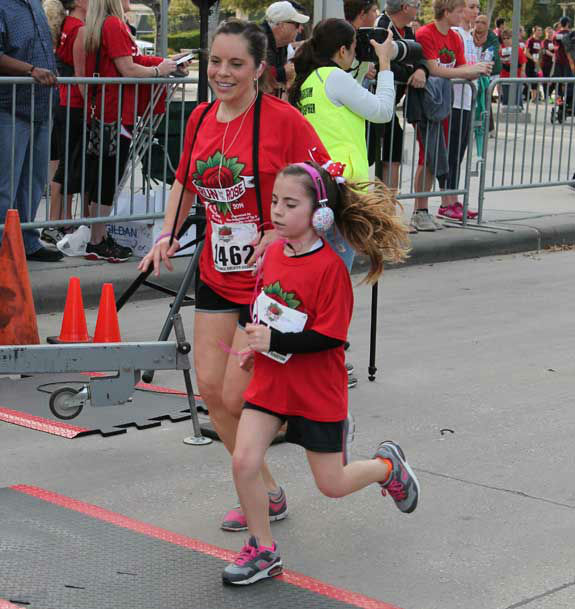 "<div class=""meta image-caption""><div class=""origin-logo origin-image ""><span></span></div><span class=""caption-text"">Runners and walkers raised money for brain cancer research and children's programs at Memorial Hermann Hospital Sunday, March 30, 2014, in the annual Run for the Rose.  The event began 12 years ago and honors Dr. Marnie Rose, who was in the first year of her pediatric medical residency at Children's Memorial Hermann Hospital when she was diagnosed with brain cancer.Were you there?  If so, send your photos to us at news@abc13.com and we'll add them here. (Photo/Meryl Walker)</span></div>"