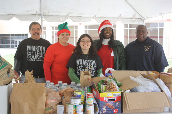 "<div class=""meta ""><span class=""caption-text "">Images from some of our Share Your Holidays locations around town and  the hard-working volunteers that made this year a HUGE sucess! (Photo/iWitness Reports)</span></div>"