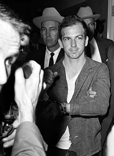 Lee Harvey Oswald, suspected assassin of U.S. President John F. Kennedy, holds up his manacled hands at police headquarters in Dallas, Texas, where he is held for questioning, November 22, 1963. &#40;AP Photo&#47;Ferd Kaufman&#41; <span class=meta>(AP Photo&#47; XCB)</span>