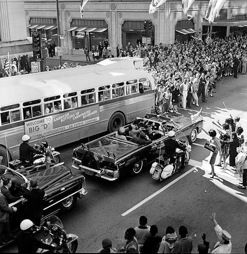 U.S. President John F. Kennedy and first lady Jacqueline Kennedy are riding in the backseat of an open limousine  on Main Street at Ervay Street as the presidential motorcade approaches Dealey Plaza in downtown Dallas, Texas, on November 22, 1963. Only moments later the ride ends in the president&#39;s assassination. Texas Gov. John Connally, who will be wounded in the ambush attack, and his wife Nellie are seated in the limousine&#39;s jump seat. &#40;AP Photo&#41; <span class=meta>(AP Photo&#47; XCB)</span>