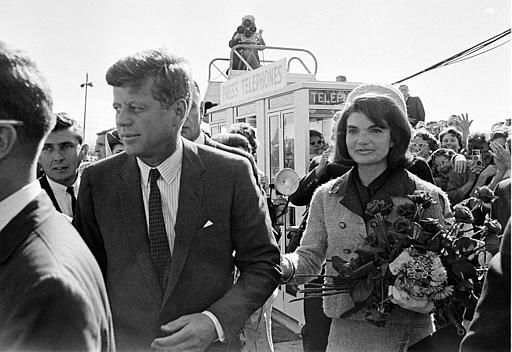 President John F. Kennedy and his wife Jacqueline Kennedy are greeted by an enthusiastic crowd upon their arrival at Dallas Love Field, on November 22, 1963. Only a few hours later the president was assassinated while riding in an open-top limousine through the city. &#40;AP Photo&#41; <span class=meta>(AP Photo&#47; XCB)</span>