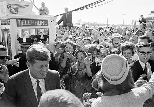 "<div class=""meta image-caption""><div class=""origin-logo origin-image ""><span></span></div><span class=""caption-text"">President John F. Kennedy and his wife Jacqueline Kennedy are greeted by an enthusiastic crowd as they arrive at Dallas Love Field,  November 22, 1963. Only a few hours later the president was assassinated while riding in an open-top limousine through the city. (AP Photo) (AP Photo/ XCB)</span></div>"