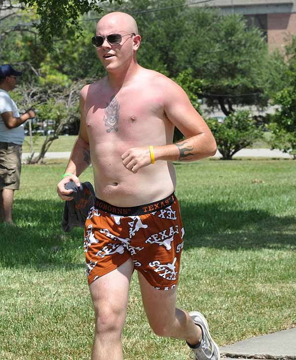 "<div class=""meta ""><span class=""caption-text "">The first Hot Undies Run was held in Rice Village on Saturday, August 21, 2010.   About 500 good sports stripped to their skivvies and braved the extreme Houston heat for a good cause, raising money for the Children's Tumor Foundation.  The two mile course through Rice University began at Brian O'Neill's Irish Pub, ending at nearby Little Woodrow's.</span></div>"