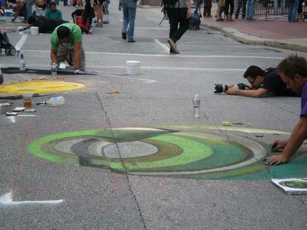 "<div class=""meta ""><span class=""caption-text "">See some of the creativity on display as the Via Colori street painting festival took over Sam Houston Park Saturday</span></div>"