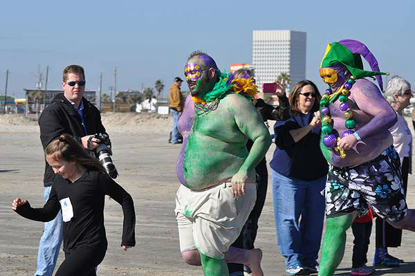 "<div class=""meta ""><span class=""caption-text "">More than 200 'plungers' were freezin' for a reason at the 2014 Polar Plunge in Galveston, Texas, on Saturday, January 18.  The chilly event invites individuals, groups and organizations to support Special Olympics Texas athletes by plunging into the water from Galveston's Stewart Beach.  This year's event raised nearly $30,000 for the charity.  Most commonly heard by those who dared brave the water -- ""I can't feel my legs!""  But judging from the smiles on their faces, it was worth the chill. (KTRK Photo)</span></div>"