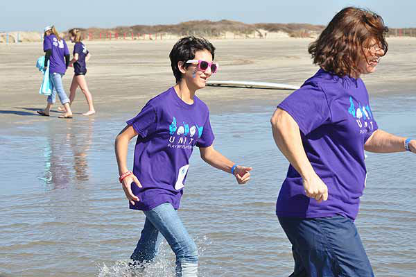 "<div class=""meta image-caption""><div class=""origin-logo origin-image ""><span></span></div><span class=""caption-text"">More than 200 'plungers' were freezin' for a reason at the 2014 Polar Plunge in Galveston, Texas, on Saturday, January 18.  The chilly event invites individuals, groups and organizations to support Special Olympics Texas athletes by plunging into the water from Galveston's Stewart Beach.  This year's event raised nearly $30,000 for the charity.  Most commonly heard by those who dared brave the water -- ""I can't feel my legs!""  But judging from the smiles on their faces, it was worth the chill. (KTRK Photo)</span></div>"