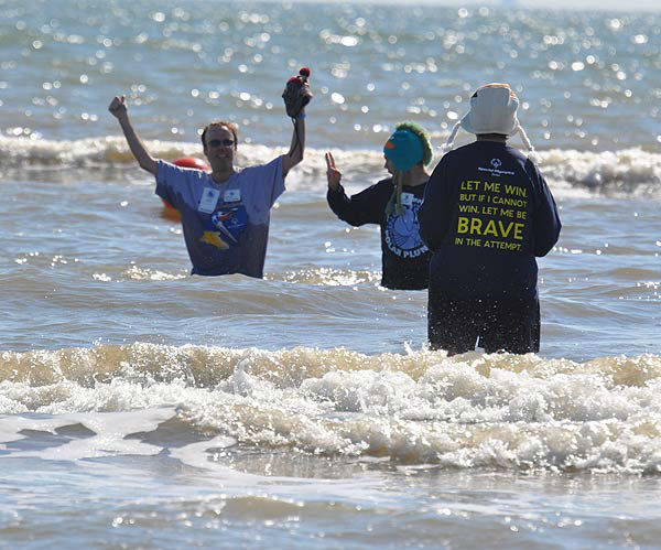 More than 200 &#39;plungers&#39; were freezin&#39; for a reason at the 2014 Polar Plunge in Galveston, Texas, on Saturday, January 18.  The chilly event invites individuals, groups and organizations to support Special Olympics Texas athletes by plunging into the water from Galveston&#39;s Stewart Beach.  This year&#39;s event raised nearly &#36;30,000 for the charity.  Most commonly heard by those who dared brave the water -- &#34;I can&#39;t feel my legs!&#34;  But judging from the smiles on their faces, it was worth the chill. <span class=meta>(KTRK Photo)</span>