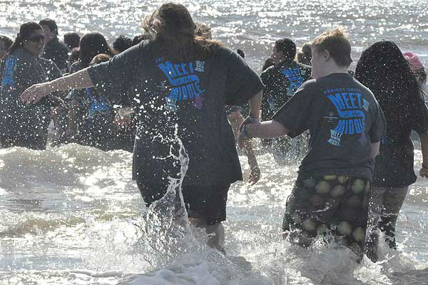 "<div class=""meta image-caption""><div class=""origin-logo origin-image ""><span></span></div><span class=""caption-text"">Brrrrave participants in the 2nd Annual Polar Plunge ran into the chilly waters of the Gulf of Mexico at Galveston Island's Stewart Beach on Saturday, January 19, 2013, to support Special Olympics Texas athletes.  The money raised provides year-round sports training and competitions for 2,041 athletes in the Gulf Coast area. (KTRK Photo)</span></div>"