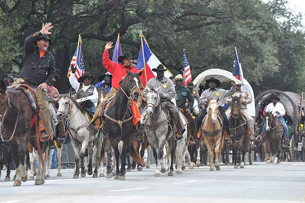 "<div class=""meta ""><span class=""caption-text "">The Downtown Rodeo Parade filled the streets of Houston with horses, wagons, music and smiles on Saturday, February 23, 2013.  The parade welcomed the trail riders in grand fashion with marching bands and floats in a celebration of Western heritage, all just before the Houston Livestock Show and Rodeo. (KTRK Photo/ Gina Larson)</span></div>"