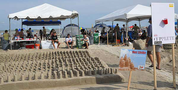 "<div class=""meta ""><span class=""caption-text "">On Saturday, June 2, 2012, contestants were having fun in the sand!  The public is invited to see how piles of sand magically transform into imaginative sculptures.  For more than two decades on the first Saturday of June, teams of architects, designers, and engineers have taken their tools to East Beach in Galveston for what is considered one of the world?s largest sand castle competitions. The Houston Chapter of the American Institute of Architects (AIA) has been organizing this competition every year since 1986. More than 60 teams had their eyes and shovels set on winning the prestigious Gold Bucket Award. (KTRK Photo)</span></div>"