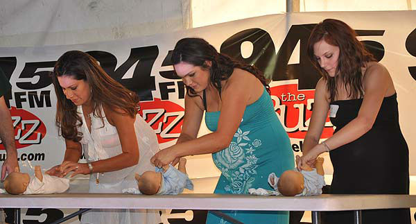 Moms-to-be came out to celebrate the beauty of motherhood at the 8th Annual Pre-Labor Day Pregnant Bikini Contest hosted by the Rod Ryan Morning Show of 94.5 The Buzz on August 30, 2012.  The women took part in a timed baby-diapering race, a diaper toss and the bikini competition.  Friends and family members came out to show their support for the women, who will soon welcome their little ones into the world. <span class=meta>(KTRK Photo)</span>