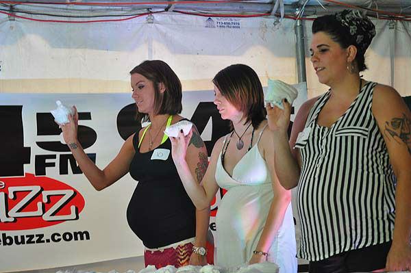 "<div class=""meta ""><span class=""caption-text "">Moms-to-be came out to celebrate the beauty of motherhood at the 8th Annual Pre-Labor Day Pregnant Bikini Contest hosted by the Rod Ryan Morning Show of 94.5 The Buzz on August 30, 2012.  The women took part in a timed baby-diapering race, a diaper toss and the bikini competition.  Friends and family members came out to show their support for the women, who will soon welcome their little ones into the world. (KTRK Photo)</span></div>"