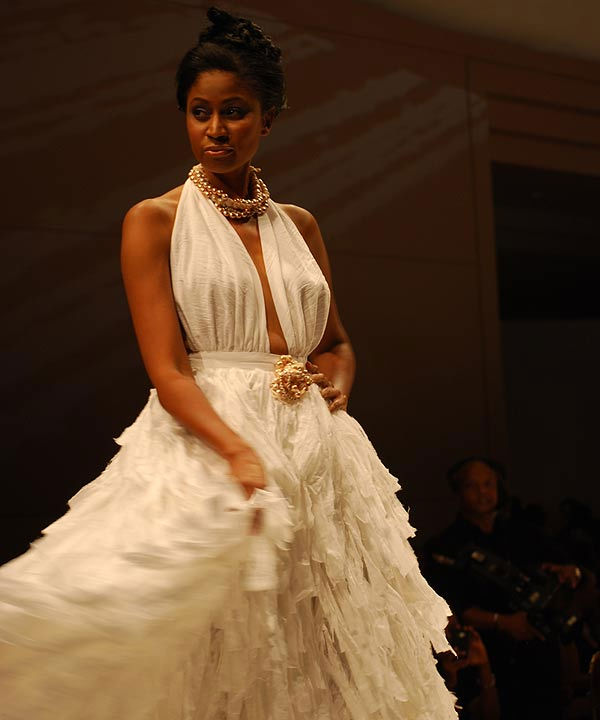 "<div class=""meta ""><span class=""caption-text "">Fashion Houston 2010 celebrated its inaugural fashion showcase with a four-day exposition of runway shows and premiere designer trunk shows.  This first of its kind fashion event brought together talented designers, celebrated models and style devotees.  On Wednesday, fashions from designers Chloe Dao, Toni Whitaker, Irina Shabayeva, Kiton and Marc Bouwer took over the runway at the Wortham Theater.  Among those attending were abc13?s own Sharron Melton, Casey Curry and Rebecca Spera. (KTRK Photo)</span></div>"