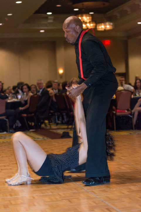 "<div class=""meta image-caption""><div class=""origin-logo origin-image ""><span></span></div><span class=""caption-text"">Amazing Race Season 7 winner Uchenna Agu dancing with partner Chelsea Lu of Fred Astaire River Oaks at the Halo House Foundation's 2013 'Houston Stars: Dancing for a Cause' gala on October 12 (Photo/Killy Photography)</span></div>"