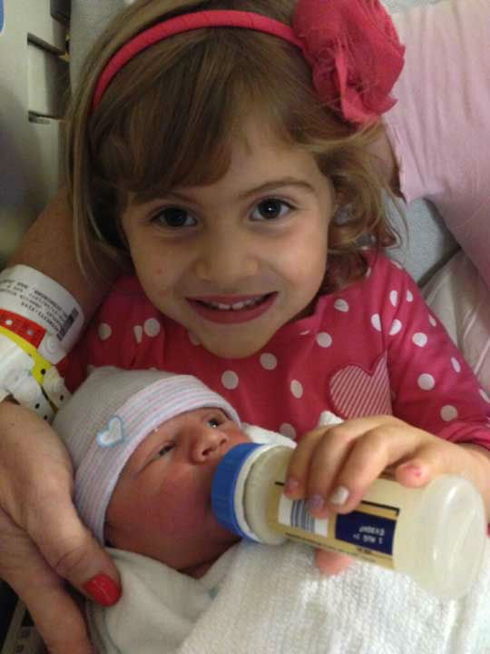 Reporter Jessica Willey&#39;s daughter Bryn, 4, feeds her new baby sister, Bobbie Anne, who was born September 30, 2013 <span class=meta>(Jessica Willey)</span>