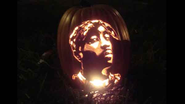 "<div class=""meta ""><span class=""caption-text "">Marsha Roberts has been carving celebrity pumpkins for this Halloween. So far, she has carved 16 but plans to make a dozen more before Halloween. The Missouri City resident has a large display of them in her yard. This one depicts Tupac Shakur. (Photo/Marsha Roberts)</span></div>"