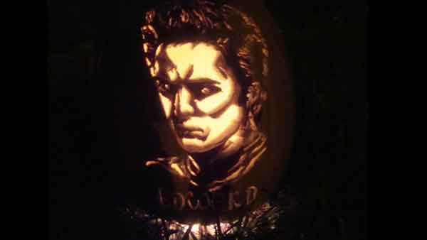 "<div class=""meta ""><span class=""caption-text "">Marsha Roberts has been carving celebrity pumpkins for this Halloween. So far, she has carved 16 but plans to make a dozen more before Halloween. The Missouri City resident has a large display of them in her yard. This one depicts Edward Cullen. (Photo/Marsha Roberts)</span></div>"