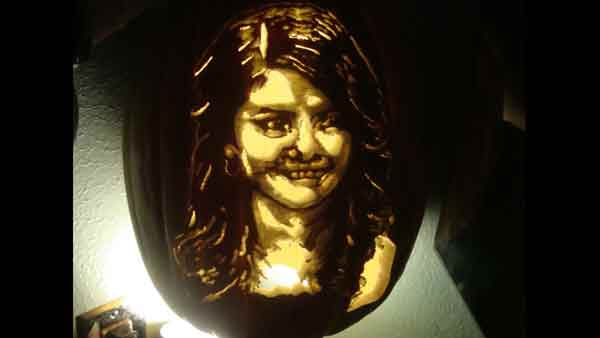 "<div class=""meta ""><span class=""caption-text "">Marsha Roberts has been carving celebrity pumpkins for this Halloween. So far, she has carved 16 but plans to make a dozen more before Halloween. The Missouri City resident has a large display of them in her yard. This one depicts Selena Gomez. (Photo/Marsha Roberts)</span></div>"
