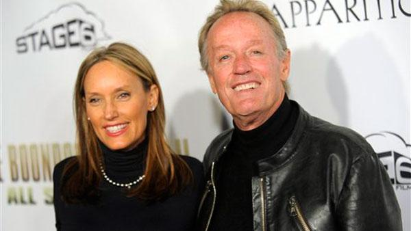 Peter Fonda, a cast member in The Boondock Saints II: All Saints Day, poses with his wife Portia Rebecca Crockett at the premiere of the film in Los Angeles, Wednesday, Oct. 28, 2009. - Provided courtesy of AP / Chris Pizzello