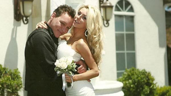 A photo of Doug Anthony Hutchinson and bride Courtney Alexis Stodden from his official website.