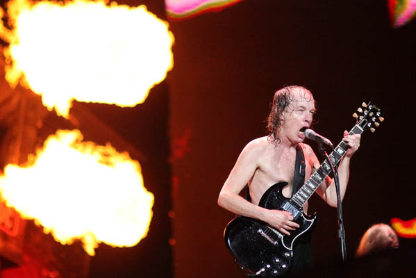 Angus Young turns 57 on March 31, 2012. The musician is known for being the lead guitarist and one of the founders of rock and roll band, AC&#47;DC.  &#40;Pictured: Angus Young is pictured performing with AC&#47;DC at Giant Stadium.&#41; <span class=meta>(www.acdc.com)</span>