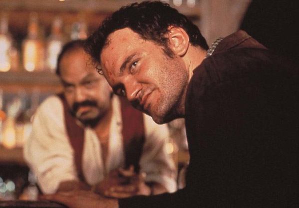 Quentin Tarantino turns 49 on March 27, 2012.  The movie director is known for films such as &#39;Pulp Fiction,&#39; &#39;Kill Bill&#39; and &#39;Inglorious Basterds.&#39;  &#40;Pictured: Quentin Tarantino is pictured in a scene from &#39;Desperado.&#39;&#41; <span class=meta>(Columbia Pictures Corporation)</span>
