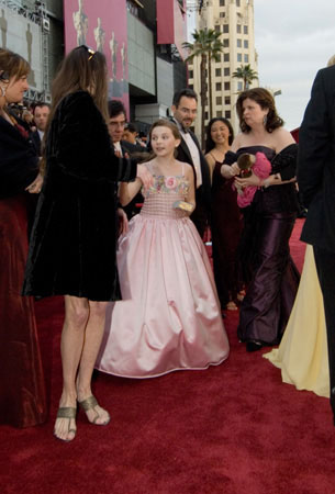 "<div class=""meta ""><span class=""caption-text "">Abigail Breslin, Academy Award nominee for Best Supporting Actress for her work in 'Little Miss Sunshine,' arrives at the 79th Annual Academy Awards at the Kodak Theatre in Hollywood, CA, on Sunday, Feb. 25, 2007 in a Simin gown.  (©A.M.P.A.S.)</span></div>"