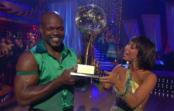 Cheryl Burke and Emmitt Smith hold up their...