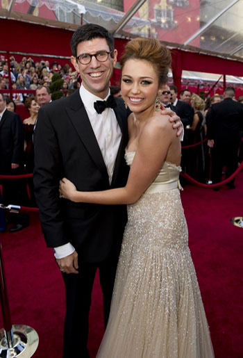 Rich Ross and presenter Miley Cyrus on the red carpet, 2010.
