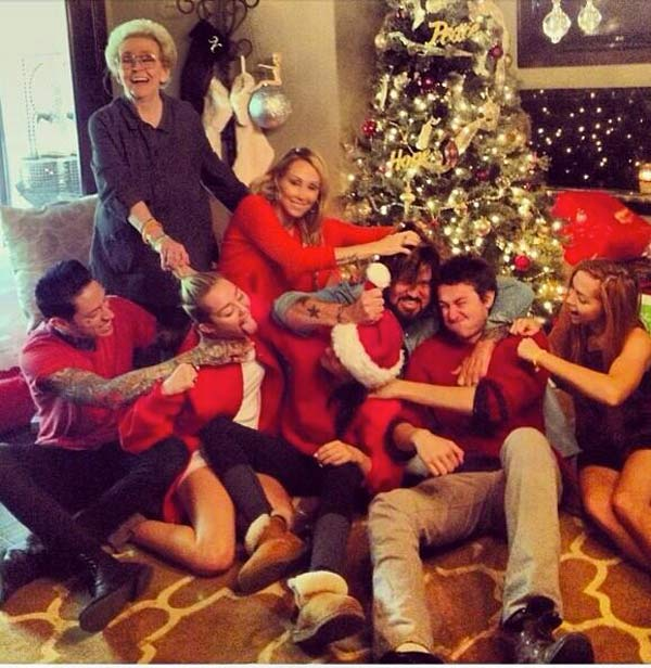 Miley Cyrus shared this Twitter photo of herself with her family on Dec. 25, 2013 - Christmas Day, saying: &#39;Annual family fist fight.&#39; On the top left is her grandmother. &#40;Check out our 2010 red carpet interview with her.&#41; <span class=meta>(pic.twitter.com&#47;MZHxEILlVr &#47; twitter.com&#47;MileyCyrus&#47;status&#47;416009348230299649)</span>