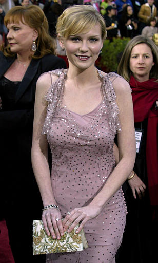 Actress and presenter Kirsten Dunst poses in a Dior gown for photographers as she arrives at the 74th annual Academy Awards on Sunday, March 24, 2002, in Los Angeles.  <span class=meta>(AP Photo&#47;Doug Mills)</span>