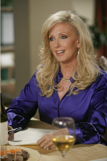 Morgan Fairchild in her role as Honey Woodcomb...