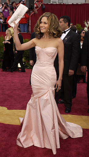 Pretty in pink once again, Jennifer Lopez arrives in a Versace gown at the 74th annual Academy Awards on Sunday, March 24, 2002 in Los Angeles.  <span class=meta>(AP Photo&#47;Laura Rauch)</span>