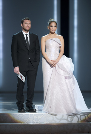 Jennifer Lopez in a Giorgio Armani Prive (right) along with Sam Worthington (left), 2010.