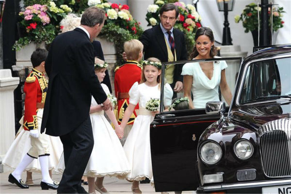 Pippa Middleton appears at her sister Kate Middleton&#39;s Royal Wedding to Prince William at Westminster Abbey in London on April 29, 2011. Pippa became famous due to her a cowl-neck, body-hugging, ivory bridesmaid gown by Sarah Burton at Alexander McQueen. <span class=meta>(Michael Bowles &#47; Startraksphoto.com)</span>