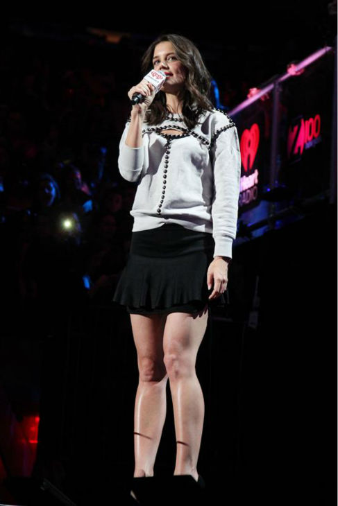 Katie Holmes appears on stage at the 2013 Z100 Jingle Ball on Dec. 13, 2013 and introduces singer Selena Gomez.