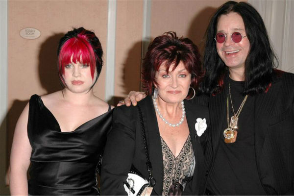 Ozzy Osbourne and wife Sharon Osbourne appear with daughter Kelly Osbourne at an event honoring actress Charlize Theron and the movie 'Monster' in Beverly Hills, California on May 7, 2004.