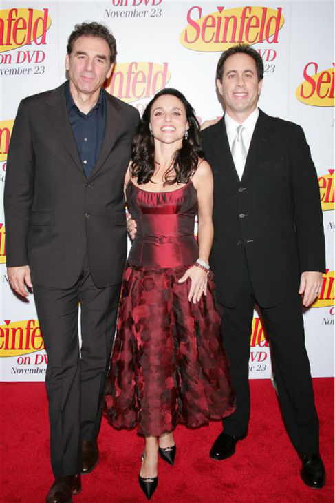 Julia Louis-Dreyfus poses with 'Seinfeld' co-stars Jerry Seinfeld (Jerry) and Michael Richards (Kramer) at a DVD release party for the hit series in New York on Nov. 17, 2004.