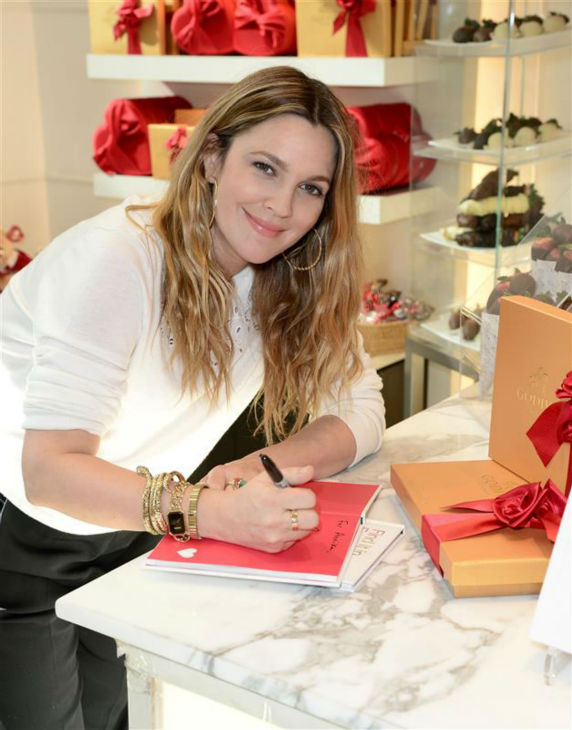 "<div class=""meta image-caption""><div class=""origin-logo origin-image ""><span></span></div><span class=""caption-text"">Drew Barrymore, who is pregnant with her second child, appears at a Godiva chocolate shop in Los Angeles on Jan. 29, 2014 to kick off a Valentine's Day partnership to promote her book 'Find It In Everything.' (Michael Simon / Startraksphoto.com)</span></div>"